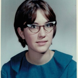 Karly's mother, Teresa, as a young woman with cat-eye glasses