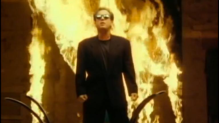 Billy Joel in front of a wall of fire