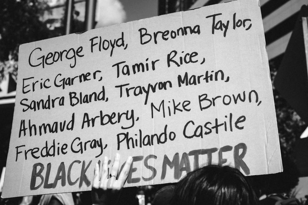 Protest sign listing the names of murdered black Americans