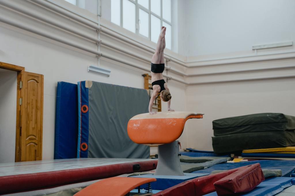 A female gymnast doing a handstand.